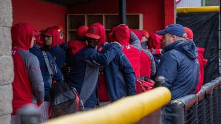 Stony Brook baseball players hug after receiving announcement