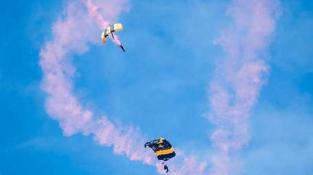 Colorful smoke trails members of the Army Golden