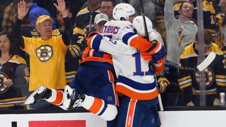 Casey Cizikas #53 and the Islanders celebrate his