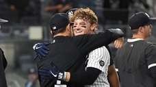 New York Yankees' Clint Frazier is embraced by