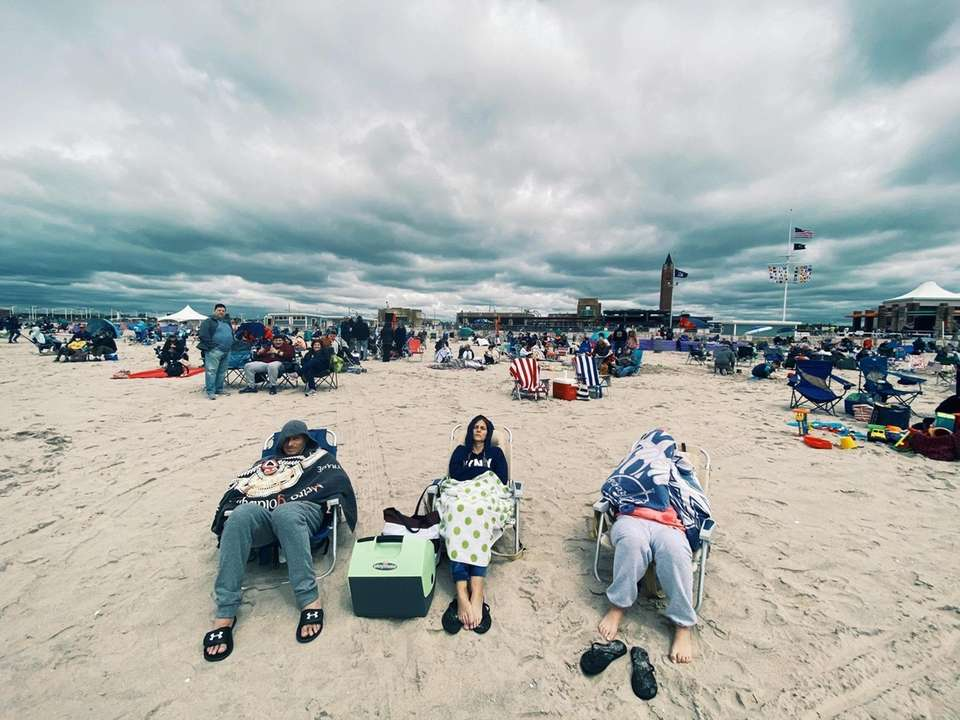 Beachgoers as the wait for the airshow to