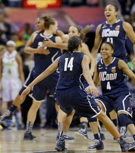Connecticut players celebrate in the women's NCAA Final