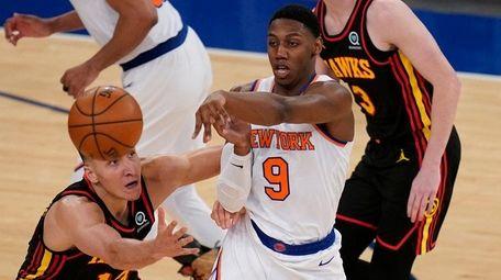 The Knicks' RJ Barrett passes the ball during