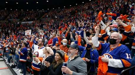 Islanders fans cheer a goal against the Pittsburgh