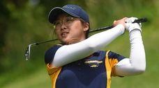 Renna Chang, Jericho eighth grader, uses an iron