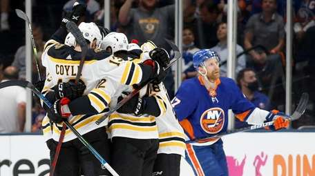 Craig Smith #12 of the Boston Bruins celebrates