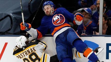 Adam Pelech of the New York Islanders checks