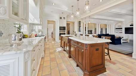 The home has a large gourmet eat-in kitchen.