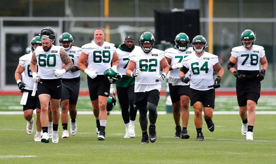 Players head to the practice field during a