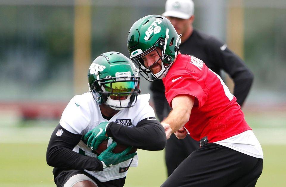 Quarterback James Morgan hands off to Michael Carter
