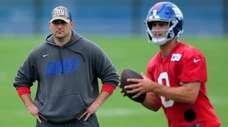 Giants head coach Joe Judge watches as quarterback