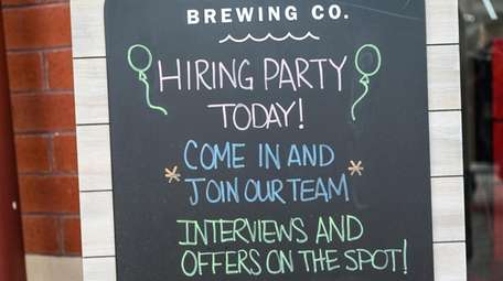 A help wanted sign at Arooga's in Patchogue,