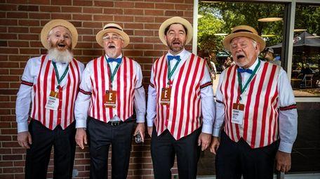 A barbershop quartet serenades attendees on Saturday, ahead