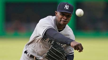New York Yankees starting pitcher Domingo German delivers