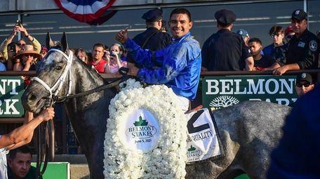 Luis Saez riding Essential Quality celebrates in the