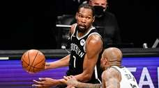 Kevin Durant #7 of the Nets is defended
