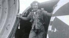 Airman Helen Grace James in a cargo door