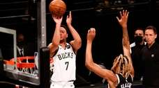 Bryn Forbes of the Milwaukee Bucks shoots during