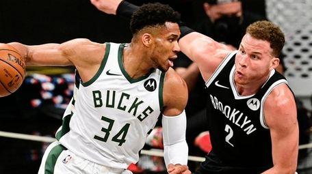 Giannis Antetokounmpo of the Milwaukee Bucks is defended