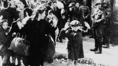 Jews being held at gunpoint by German SS