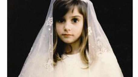Sinead O'Connor in her communion dress.
