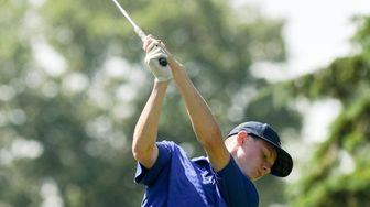 Kevin Mahone of Kellenberg swings through his drive