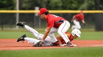 Matt Travaglia of Chaminade returns to first base