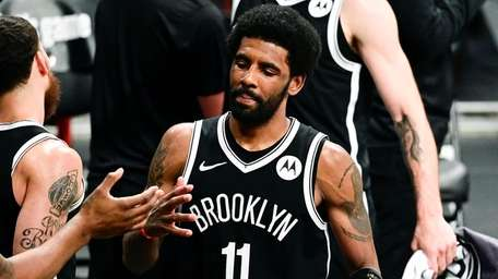 Kyrie Irving of the Nets is congratulated by