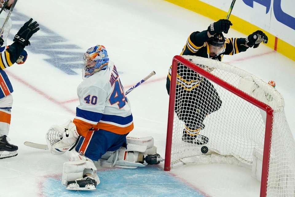 Boston Bruins center Brad Marchand, right, celebrates a