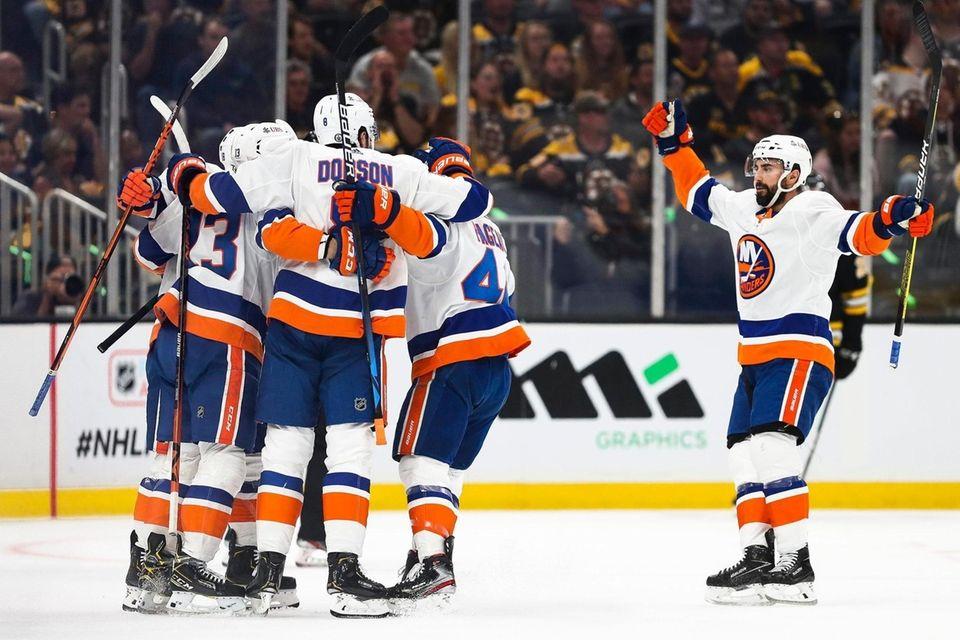 Mathew Barzal of the Islanders reacts with teammates