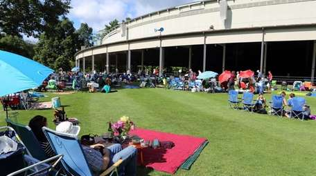 People assemble on the lawn of Tanglewood in