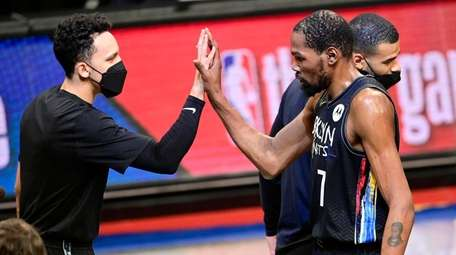 Kevin Durant of the Nets congratulated by Landry