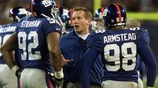 Giants head coach Jim Fassel talks with Michael