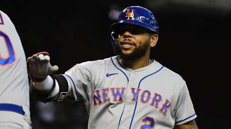 Dominic Smith #2 of the Mets celebrates with