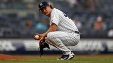 Gerrit Cole #45 of the Yankees reacts against