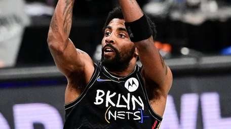 Kyrie Irving of the Brooklyn Nets attempts a