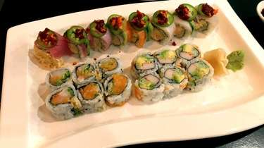 A chili rainbow roll with spicy crab, salmon,