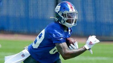 Giants wide receiver Kadarius Toney participates in drills