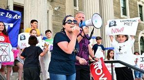 Demonstratorsheld a rally in Mineola on Wednesday todemand