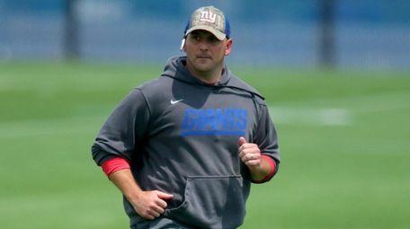 New York Giants head coach Joe Judge runs