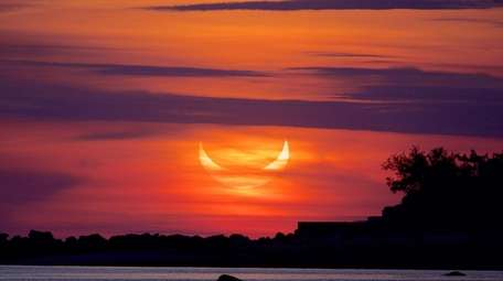 A partial solar eclipse is seen from Stehli
