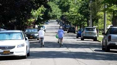 Bicycling down Bellmore Avenue in Floral Park