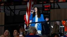 Nicole Raviv sings the national anthem before Game