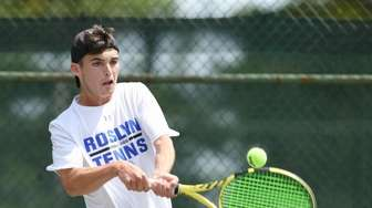 Mikey Weitz of Roslyn returns the volley during