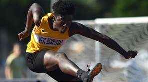 Oluwadolapo Babalola of West Hempstead clears an obstacle