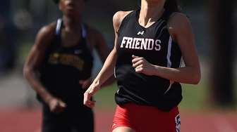 Caroline Green of Friends Academy races to victory
