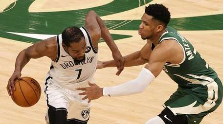 Kevin Durant of the Brooklyn Nets is defended