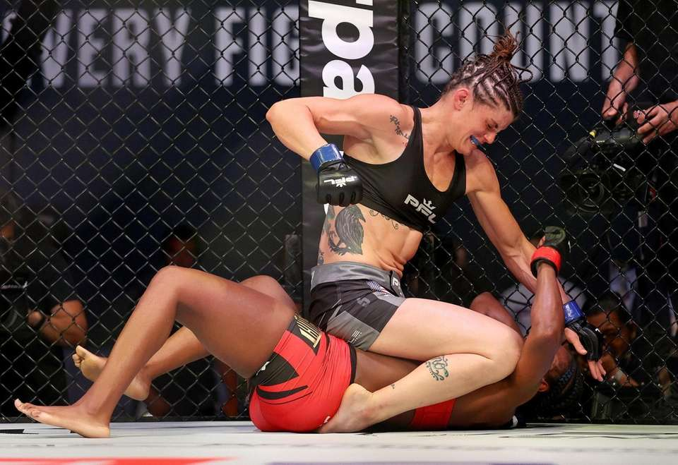 Brittney Elkin of the United States punches Claressa
