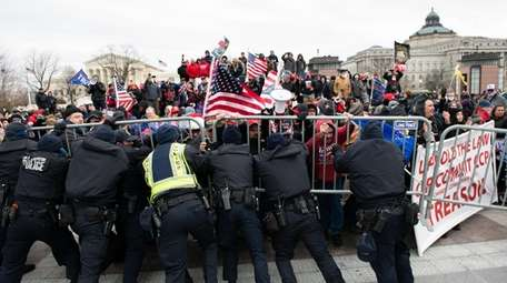 U.S. Capitol Police scuffle with demonstrators after they