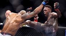 UFC middleweight champion Israel Adesanya kicks challenger Yoel